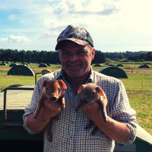 trevor with piglets